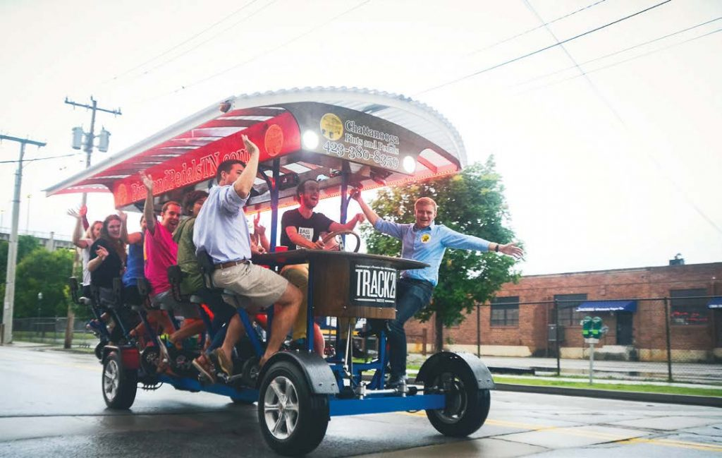 Chattanooga offers a vibrant downtown scene that draws millennials. Pictured is Pints and Pedals — the original and ultimate bike pedal tour bar crawl. (Photo provided)