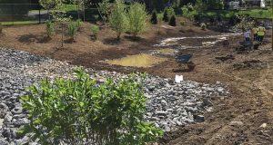 "Construction of the created wetland in Albany was ongoing in this photo and water was already starting to collect. The wetland was part of a two-part solution to mitigate flooding in a neighborhood of the city that fell victim many times to ""horrific flooding."" The city also installed an underground detention gallery under a baseball field in the neighborhood. (Photo provided)"