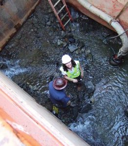 Danelle Murray isn't afraid to literally get down in the trenches as a part of her career as an engineer. Murray was recognized by the American Public Works Association in part for leading innovations in water system modeling, stormwater modeling and the promotion of sustainable infrastructure. (Photo provided)