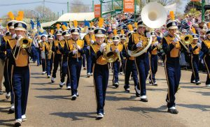 A marching band performs in the Tulip Time Festival, which draws in crowds of more than half a million. (Photo provided)