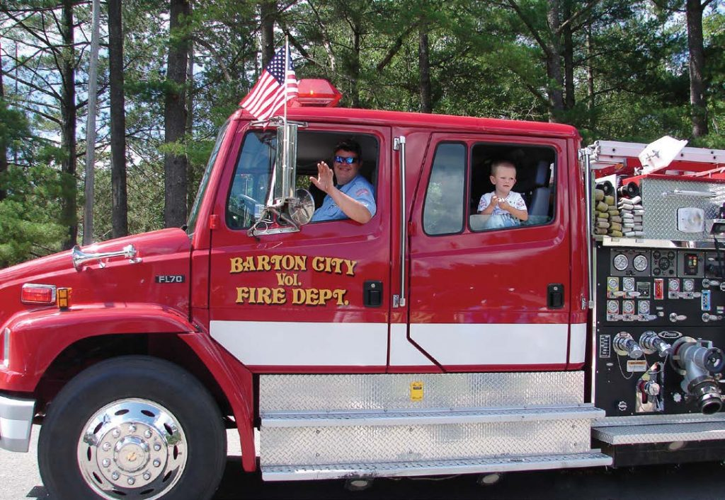 Barton City Volunteer Fire Department gets in the Fourth of July spirit during the Fourth of July parade. (Photo provided)