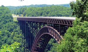 The New River Gorge Bridge, one of the world's longest and highest steel arch bridges, spans the New River in the Appalachian Mountains a few miles southeast of The Mystery Hole. (bobistraveling via Flickr, creativecommons.org/licenses/by/2.0/)