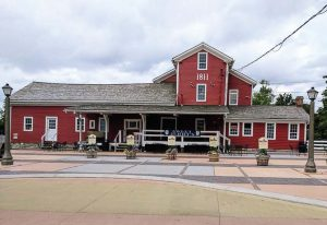 The historic Williamsville water mill was restored as part of the East Spring Street Project. It was purchased by Sweet Jenny's Ice Cream, and a plaza was built for events and gatherings to help make it a hub of the village once more. (Photo provided by the village of Williamsville)