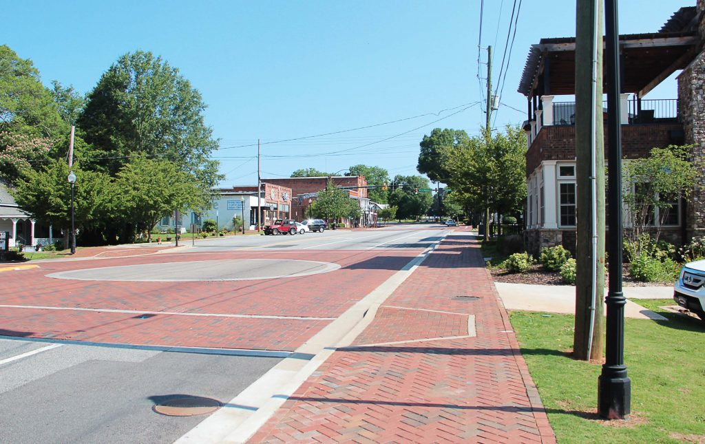 Kennesaw, Ga., passed ordinance Sec. 34-21 in 1982, which mandates that residents own a gun; however, the city included plenty of loopholes so residents actually don't have to own one. Pictured is Kennesaw's Main Street. (Public domain)
