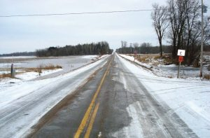 Pictured are roads in Polk County, Wis., that have been treated with a cheese brine mixture. (Photos provided)