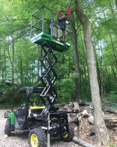 Attached to a John Deere Gator, this UTX is used to perform forestry work. With its easy-touse adaptors, the UTX Scissor Lift can be shared across city departments. (Photo provided)