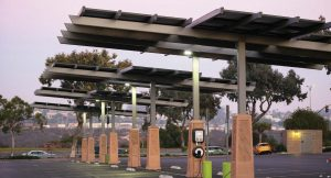 EV stations have a 10-year or more life span and are pretty low maintenance. With a networked station, there are over the air upgrades that occur throughout the life of that station. Pictured is a solar-powered EV station in a public parking lot in San Diego, Calif. (Joshua Rainey Photography/Shutterstock.com)