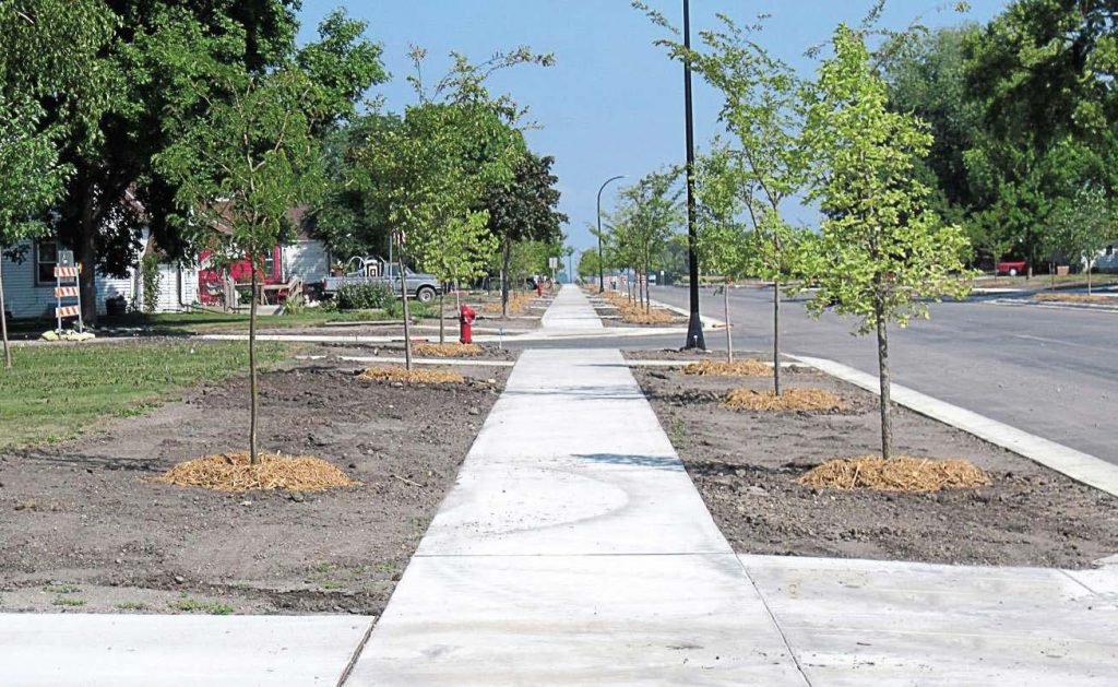 Sidewalks across the country are expanding to improve pedestrian safety while roadways shrink. These smaller roads improve drivers' safety, too, by encouraging them to pay more attention. (Photo provided)