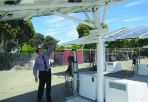 Interim Assistant Director of the Bureau of Infrastructure and Operations Richard Battersby feels the benefits of solar energy. While the units are expensive, they do guarantee that electric vehicles charged there are using 100 percent renewable energy. (Photo provided)