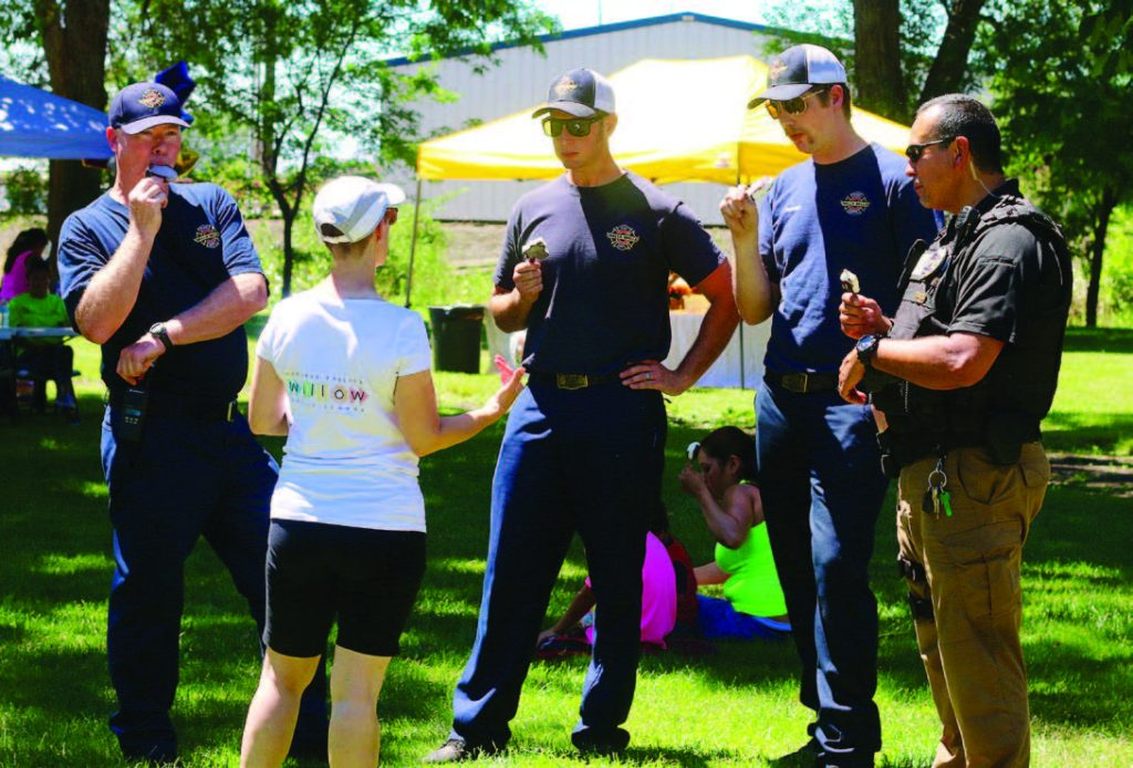Walla Walla firefighters enjoy some of the free ice cream at one of the city's block parties while connecting with residents. (Photo provided)