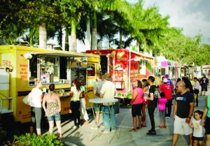 People line up at a variety of food trucks to sample their wares during a concert at the Wellington Amphitheater. (Photo provided)