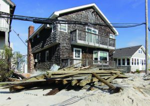 Homes along the beach in Seaside Heights, N.J., had downed utility lines and piles of boardwalk planks in their yards — if they were lucky enough to escape being damaged in the devastation left from Hurricane Sandy. The borough along the coast had a double whammy when several months later a fire took out nine blocks of boardwalk. (Photo provided)