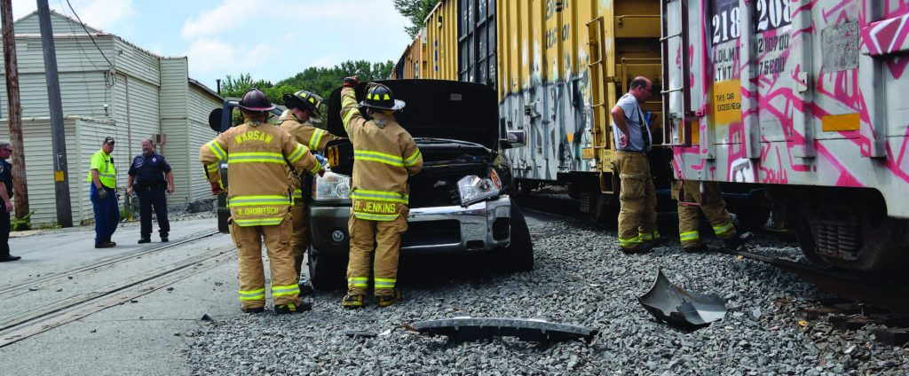 Kosciusko County, Ind., underwent an intensive hazardous material drill in 2017. During the drill, it was determined that communications were a weak point that could hinder responses during the real event. Pictured, emergency responders with the Warsaw-Wayne Fire Territory in Kosciusko County evaluate a truck after it was struck by a moving train in July. (Photo by Maggie Kenworthy/Ink Free News)