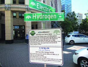 A sign educates citizens on Oakland's electric and hydrogen vehicle programs. (Photo provided)