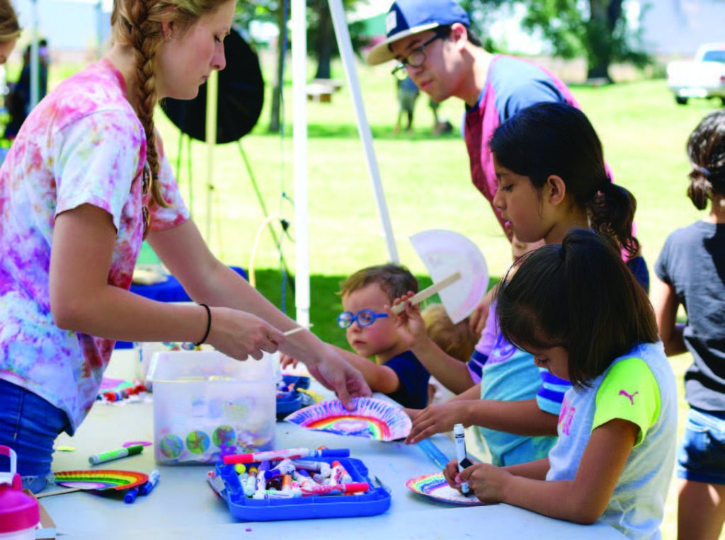 Children complete art projects during one of the summer block parties. (Photo provided)