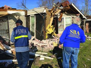 Teams of representatives from the Federal Emergency Management Agency, Small Business Administration and state of Louisiana survey the damage from a tornado in New Orleans in February of 2017. Once disasters like this happen, it's important to document all expenses in order to be reimbursed and to pass a federal audit. (Photo provided)