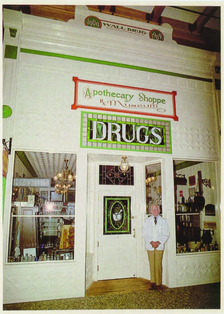 Wall Drug founder Ted Hustead poses in front of the Apothecary Museum, a replica of the original drug store founded in 1909, two years aft er the town's founding. Hustead purchased the store in 1931. (Photo provided)
