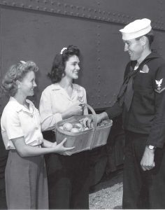 "Young women, 16 and older, served as ""platform girls"" who would greet the soldiers debarking from the troop trains during brief refueling stops."