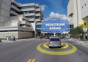 As pedestrians cross East Twiggs Street using the mid-block crosswalk at the Hillsborough County Courthouse, approaching drivers whose cars are equipped with CV technology will receive an alert that a pedestrian is in their path. (Photo provided)