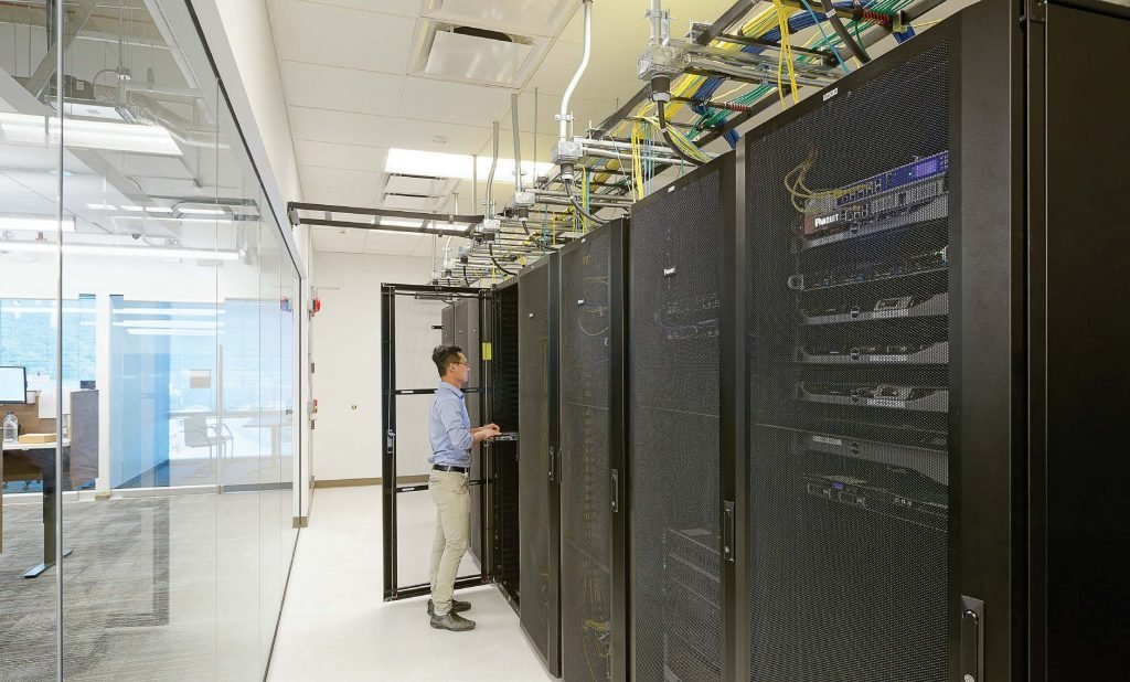 A Sandy Springs, Ga., IT staff member visits the server room. Sandy Springs outsources its IT work but the staff works onsite. (Photo provided)