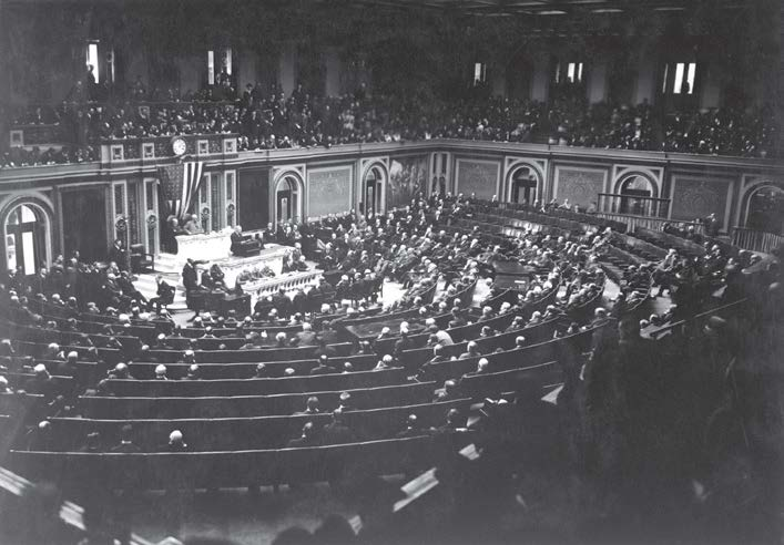 President Woodrow Wilson reads the armistice terms to Congress. The armistice, which was signed Nov. 11, 1918, officially brought World War I to an end. Wilson would later recognize Nov. 11 as Armistice Day in 1919; ultimately, the holiday changed to Veterans Day following World War II. (Shutterstock.com)