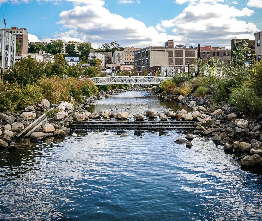 """Van der Donck Park at Larkin Plaza features the restored Saw Mill River and boardwalk in downtown Yonkers, N.Y. The river was actually covered up underneath the city with a parking lot atop it and was """"daylighted"""" and transformed into a nice park in 2012. (Photo provided by Yonkers)"""