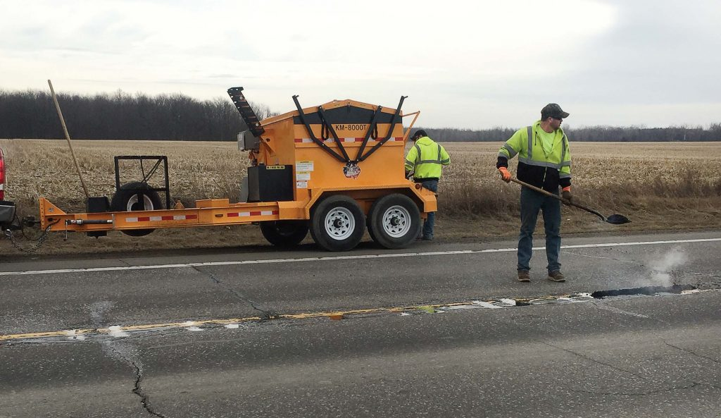 Utilizing the right methods and equipment can stop the never-ending repair cycle of potholes and other road defects. KM International's KM T-2 Asphalt Recycler can help municipalities better manage the costs of road maintenance. (Photo provided)