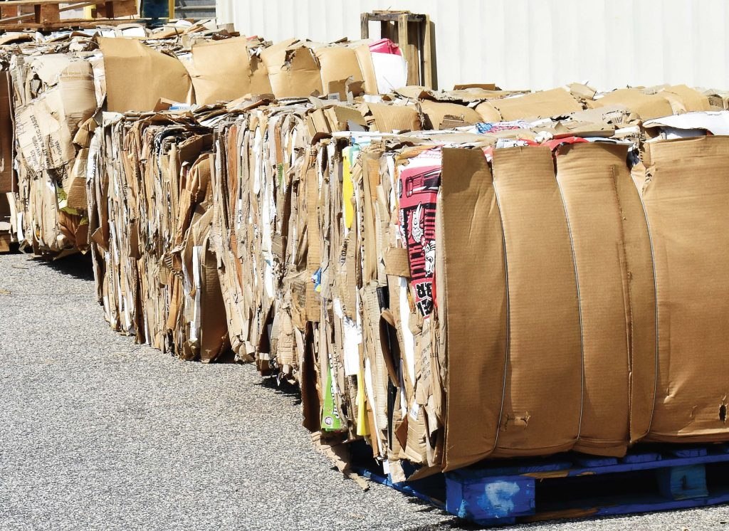 Large bundles of compressed cardboard await pickup in Greenville, S.C. Many recycled materials in the U.S. are exported to China and other countries to be made into other products. (Alan Stoddard/Shutterstock. com)