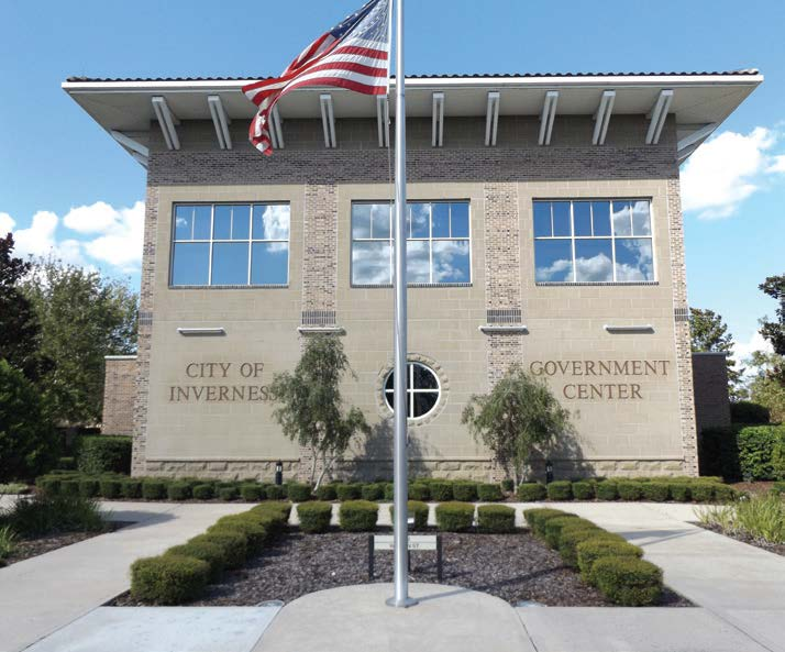 Inverness, under the leadership of City Manager Frank DiGiovanni, has invested in its downtown and launched a new capital improvement project in November. Pictured is the city's government center and city hall. (Photo by Denise Fedorow)