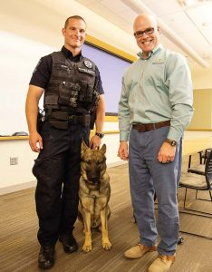 Meeting with city employees is another important aspect of Spurgeon's career as city manager. He enjoys helping them reach their own career goals. Pictured, from left, are Officer Mike Ryan, K9 Thor and Spurgeon. (Photo provided)