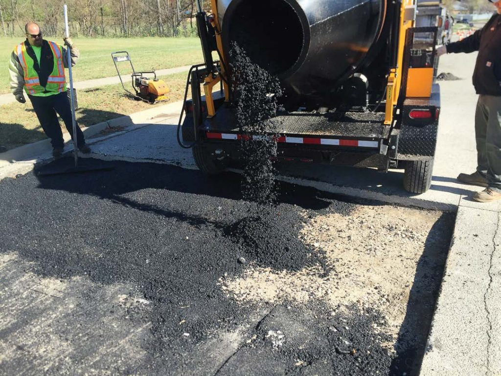 By removing debris and moisture from the repaired area, workers will ensure that the new material will better bond with the repair area. Picking the right material and allowing for proper compaction also play major roles in a successful repair job. (Photo provided)