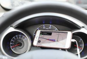 Cities can share GIS data, integrating it with mobile applications like Waze, pictured. This sharing of information can lead to improved traffic flow. (Shutterstock.com)