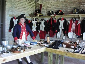 A Fort Gaines re-enactor displays colonial apparel and other memorabilia.