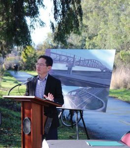 Ed Shikada speaks at a ceremony where the city of Palo Alto signed agreements for a new pedestrian and bike bridge on Dec. 17, 2018. (Photo provided)