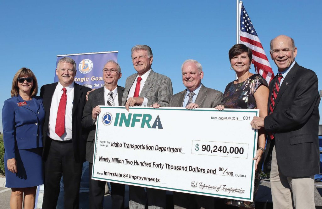 "ITD did not expect to receive the full grant amount it had requested but was pleasantly surprised when its thoroughness paid off, earning it the largest grant in its history. Pictured from left are Idaho Transportation board member Julie DeLorenzo; Ada County Commissioner Dave Case; Caldwell Mayor Garret Nancolas; Idaho Gov. C.L. ""Butch"" Otter; ITD Director Brian Ness; Federal Highway Administration Deputy Administrator Brandye Hendrickson; and Canyon County Commission President Tom Dale. (Photo provided)"