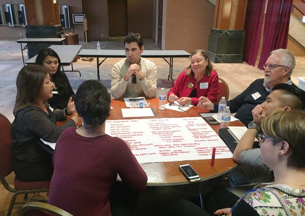 A group of people gather for a Welcoming San Diego community planning forum where they brainstorm how to better work with immigrants in their city. Welcoming San Diego is a partner organization with New American Economy. (Photo provided by Welcoming San Diego)
