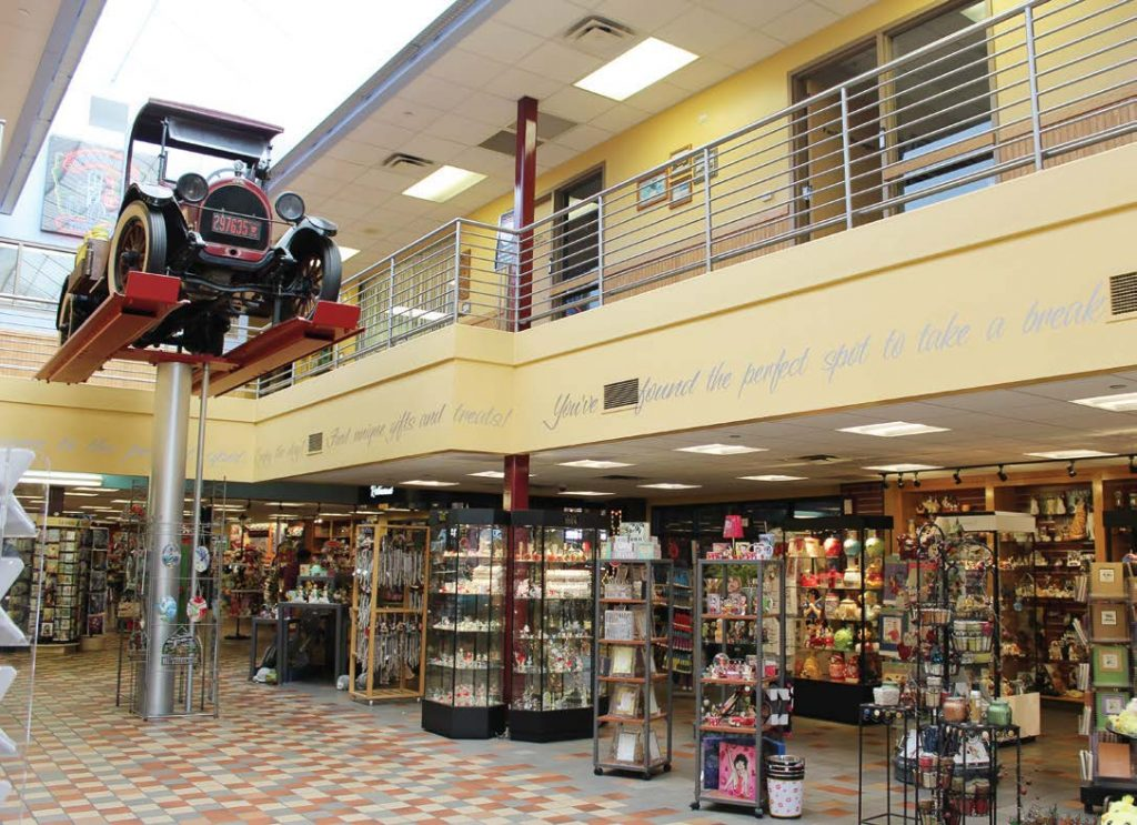 A vintage truck towers above patrons in the spacious main building of Iowa 80 Truckstop in Walcott.