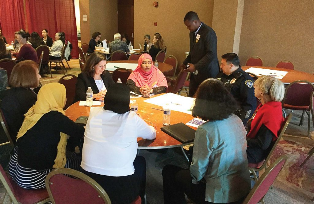 A group of diverse people gather at a community planning forum sponsored by Welcoming San Diego. There they work on ideas to make San Diego a welcoming city for immigrants. (Photo provided by Welcoming San Diego)