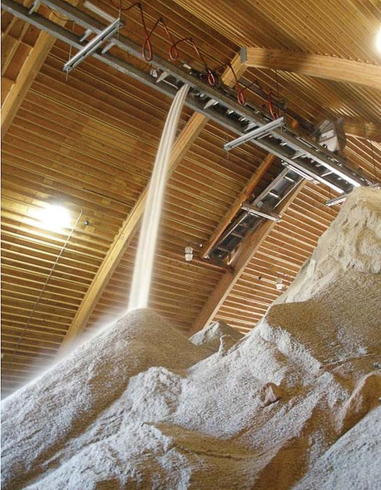 "An inside view of the material storage facility, or ""salt barn,"" as it is fi lled with salt. The city has the capability of coating the salt with liquid product using the automated spray system. (Photo provided by the city of Fort Collins, Colo.)"
