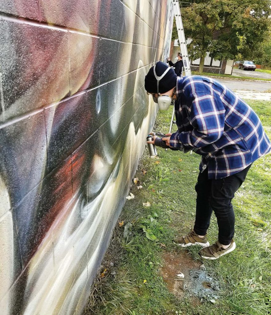 Totem Books, the most recent mural site in Flint, Mich., is only one painted section of the city and has brought countless visitors already. Local and national artists have visited Flint to partake in the public art projects. (Photo provided)