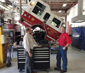 Since the city owns and maintains 326 vehicles and other pieces of equipment, its primary goal is to ensure that the vehicles are safe, reliable and perform their necessary functions. Pictured are Michael Magnuson, left, director of public works, and Don Christenson, fleet and facility services superintendent. (Photo provided by the city of Crystal Lake, Ill.)