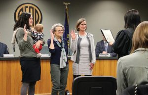 Sally Russell, right, takes the oath of her new offi ce as the fi rst elected female mayor of Bend, Ore., alongside councilors, from left ,Gena Goodman-Campbell and Barb Campbell. (Photo provided)