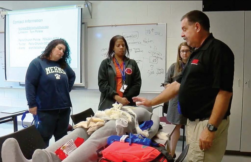 "Instructors who are trained in Tactical Emergency Casualty Care, or TECC, teach the basic concepts of ""Stop the Bleed."" This includes the use of tourniquets and occlusive dressings. (Photo provided)"
