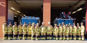 Wilton volunteer firefighters pose with their new turnout gear. (Photo provided)