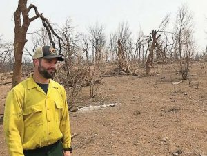 Jason Forthofer, mechanical engineer, stands in an area burned by the Carr Fire, one of the devastating California wildfi res in 2018. (Photo provided by Bret Butler, U.S. Forest Service)