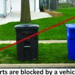 Recycling Carts blocked by a vehicle